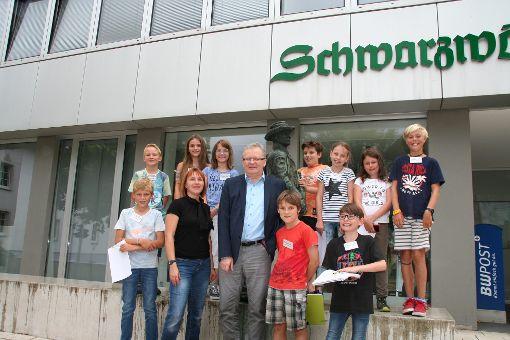 Die Kinderreporter mit Chefredakteur Hans-Peter Schreijäg. Foto: Ilse Rapp