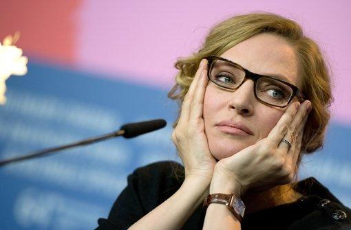Warum so traurig, Uma Thurman? Die Brille ist doch todschick. Foto: dpa